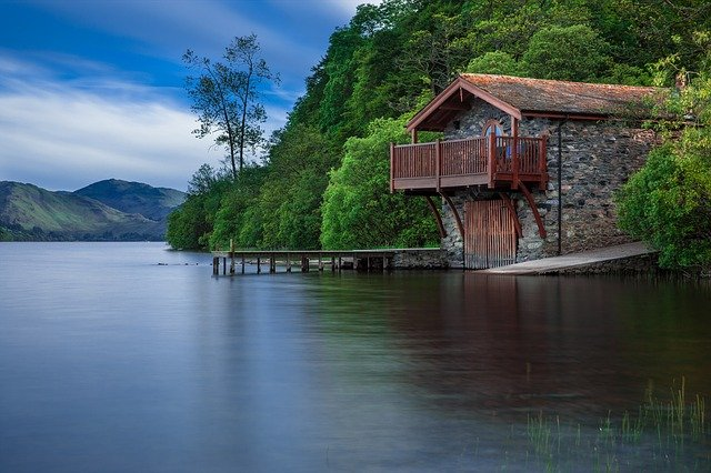 A small house surrounded by a body of water