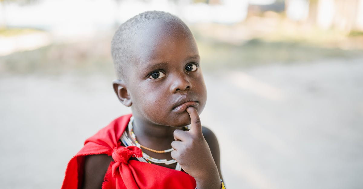 A little boy looking at the camera