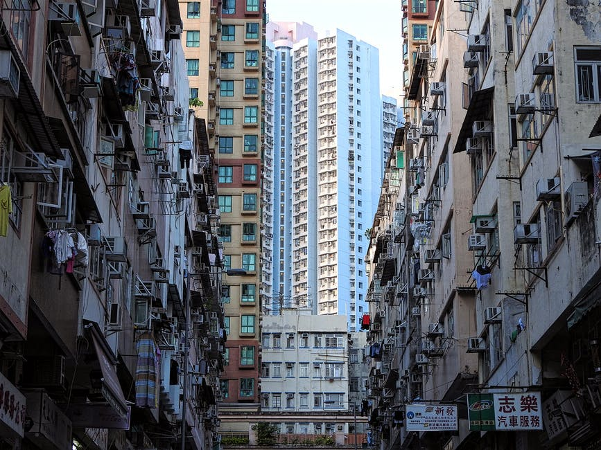 A crowded city street surrounded by tall buildings